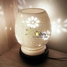 đèn xông tinh dầu hoa mai