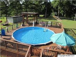above ground round pool with deck. Here We See Another Deck All The Way Around A Round Above-ground Pool. This  Is An Amazing Gathering Spot For Family Pool Times. Above Ground With E