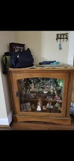 very nice wood cabinet with glass door item must be picked up in overland off of st charles rock road furniture in olivette mo offerup