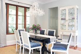 black dining table with blue velvet dining chairs