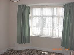 top curtains for bay windows how to hang