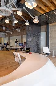 Plus Reception Desk Chairs And Chandelier At Giant Pixel Headquarters In San Francisco Designed By Studio Giant Pixel San Francisco Headquarters By Studio Oa
