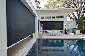 rectractable motorized patio screens roll up patio screens the shade houston tx