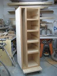 ironing board furniture. build shelves for laundry baskets with space ironing board alongside furniture