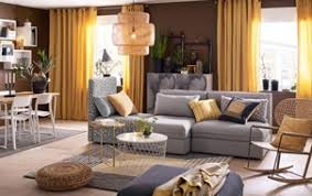 sofa table in living room. A Medium Sized Living Room Furnished With A Three-seat Sofa Combination In  Plain Gray Table
