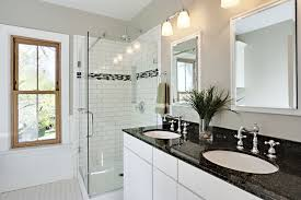bright bathroom with white subway tile and black galaxy granite vanity countertop
