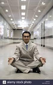 meditation businessman office. Businessman Practicing Yoga In An Office - Stock Image Meditation O
