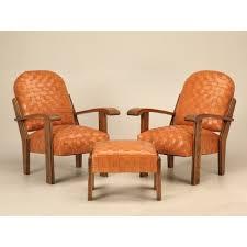 pair of custom leather club chairs w ottoman