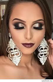 glam makeup and earrings