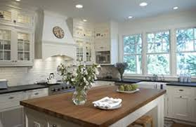 white cottage kitchens. Three Large Windows Were The Starting Point For Susan Klimala\u0027s Kitchen. Farmhouse Sink And White Painted Cabinets Exemplify Cottage Design Style Of Kitchens