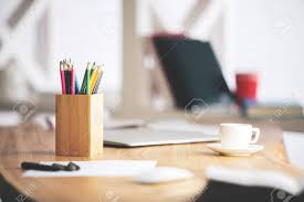 top office table cup. Close Up Of Office Desk Top With Book, Coffee Cup, Supplies And Other Objects Table Cup