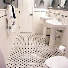 the shower floor is hexagon shaped marble tiles with darker gray