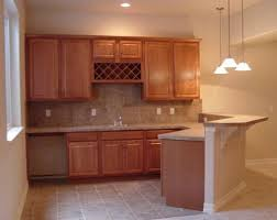 wet bar lighting. Basement Wet Bar Cabinets With Tile Flooring And Pendant Lighting Plus Floating Shelves Also Wine Rack For Kitchgen Design Ideas