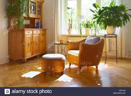 Warm Color For Living Room Sunny Living Room In Warm Colors With Cozy Wicker Armchair And