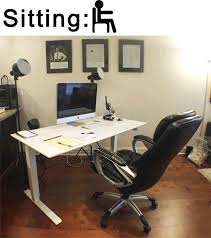 sitting and standing desk gif