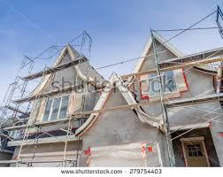 exterior paint application. scaffolds surrounding home following application of smooth exterior stucco but prior to painting. located paint