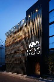 a facade of wood latticework covers this anese restaurant