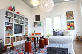 Cool Playroom ideas: If you have a TV, hide it so it's not the