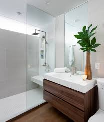 Bathrooms:Awesome Bathroom With Small Solid High End Vanity And Wall Mirror  Near Shower Cubical
