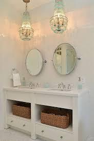 coastal bathroom designs: coastal bathroom with turquoise chandeliers  coastal bathroom with turquoise chandeliers