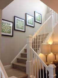 oversized wall decor going up stairs