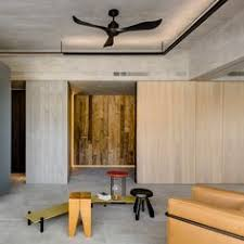 large panels of glazing and aged pieces of wood helped wei yi international design ociates create