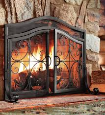 large crest fireplace screen with doors