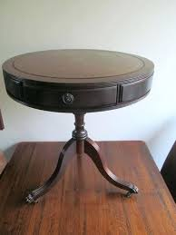 round side table with drawer round side table with three drawers and a green leather table
