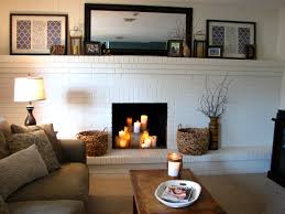 classy white brick painted fireplace mantel also artworks decor as well as brown fabric sofa in country living room designs ideas
