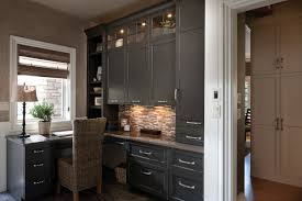 traditional custom home office. A Stylish Home Office Designed By Mingle, Featuring Dura Supreme Cabinetry. Door Style: Arcadia Panel In Custom Rubbed-thru Finish. Traditional