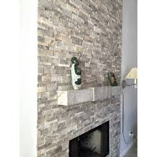 white stacked stone family room remodel built in shelving fireplace wall