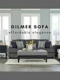affordable and elegant living room sofa wrapped in a dark grey fabric