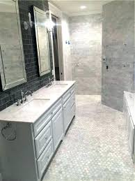 carrara marble tile bathroom marble tile bathroom transitional with black subway hardwood flooring professionals marble tile