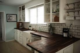dark wood countertops modern white cabinets kitchen new york throughout 1