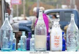 close up of old colored glass bottles at an outside antique stock image milk vintage milk bottles antique bottle