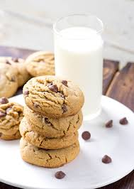 chocolate chip cookies and milk. Plain And Thick Soft Peanut Butter Chocolate Chip Cookies Next To A Glass Of Milk Throughout Chocolate Chip Cookies And Milk O
