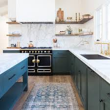 have an all white kitchen a persian rug is sure to add a fun pop while showing wear might be unfortunate in many rugs a faded persian rug gives it a