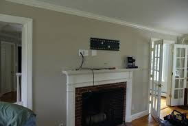 how to hang tv over fireplace wall mount over fireplace hiding wires hang tv above fireplace