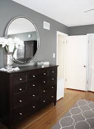 bedroom colors with black furniture. Benjamin Moore Amherst Gray In This Bedroom With A And White Patterned Rug, Trim Dark Wood Furniture. Round Mirror, Wall Color, Grey Wall, B Colors Black Furniture T