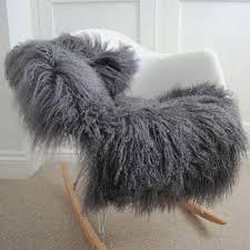grey curly tibetan luxury long haired sheepskin rug on chair