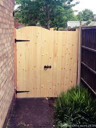 wooden garden gate curve top