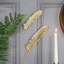 pair of antique gold feather wall art decorations on feather heart metal wall art with wall art vintage pictures plaques wall accessories from melody