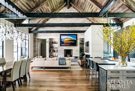 classic board and batten is juxtaposed with modern metal details for a fresh farmhouse feel the pool was designed by j brownlee design of nashville