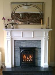 this old house gas fireplace we installed new quarter tiles on the face of this old