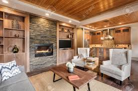 Living Room Interior With Wood Strip Ceiling And View Of Kitchen