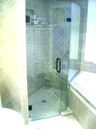 penny tile bathroom shower floor blue round black and white s