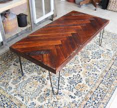 This DIY herringbone coffee table is beautiful! She used reclaimed wood but  you could get