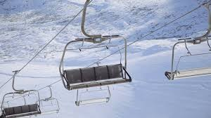 ski lift or chairlift of an empty ski resort at winter day on mountain slopes stock footage blocks