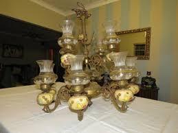 vintage 12 arm brass and porcelain chandelier