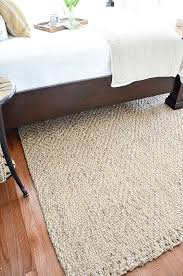 the first thing i did in my guest room to get it ready for the ds of summertime guests and family was to add a new sisal rug under the bed